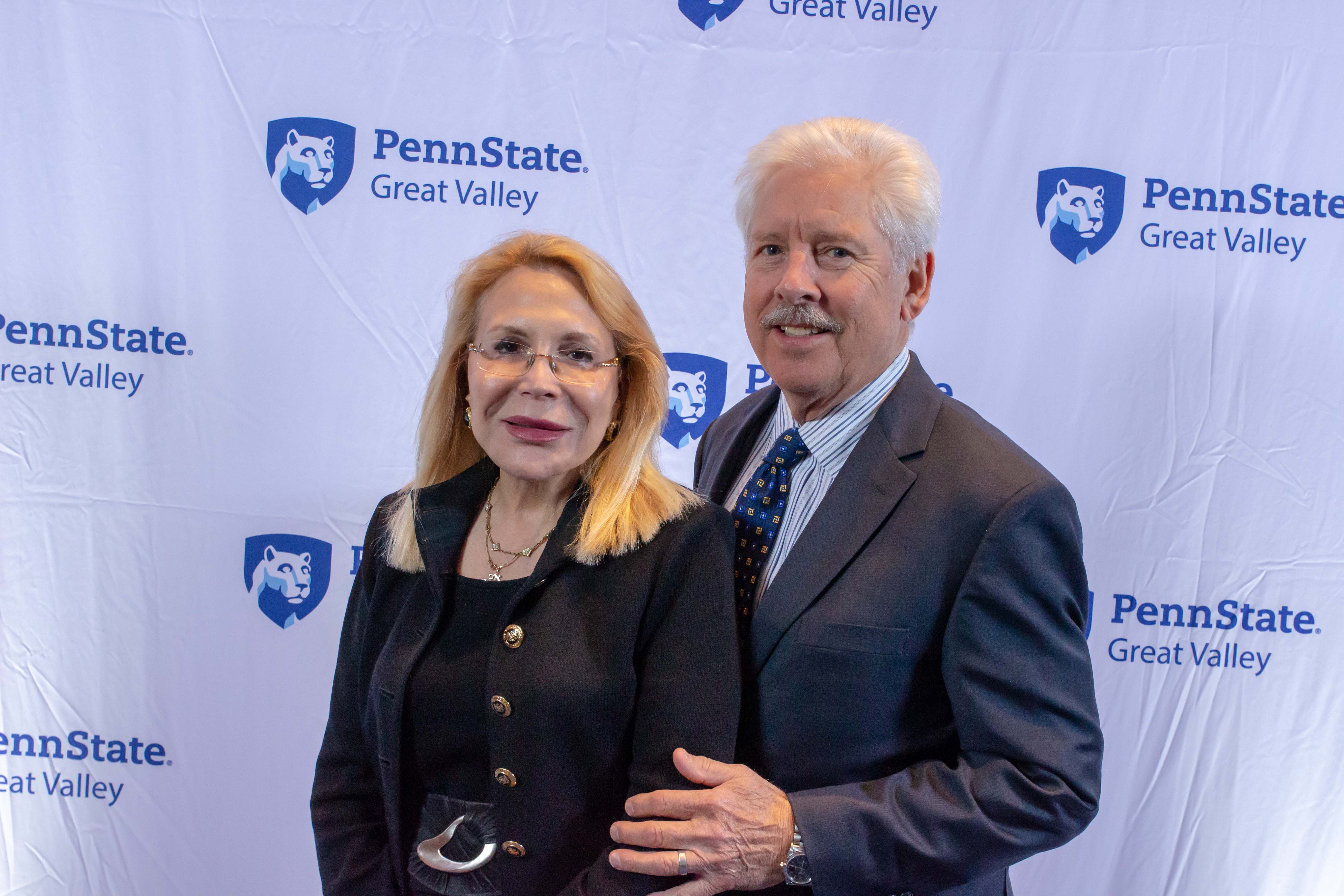 Drs. Michael and Madlyn Hanes standing in front of a Penn State Great Valley backdrop