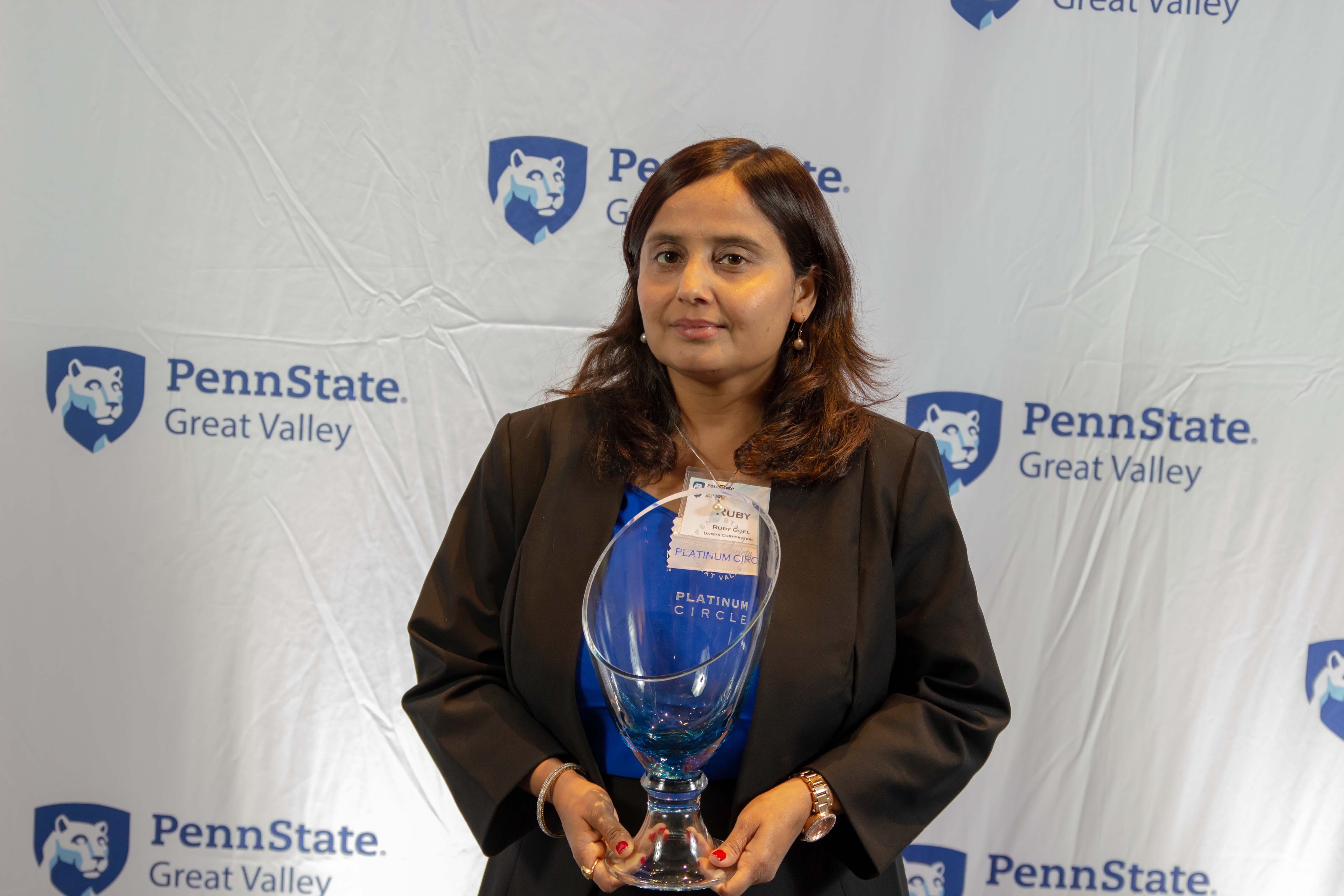 Unisys Corporation's Ruby Goel with a Platinum Circle vase