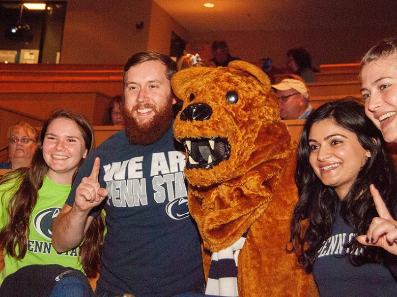 Alumni pose with the Nittany Lion at the Penn State Great Valley Alumni Awards