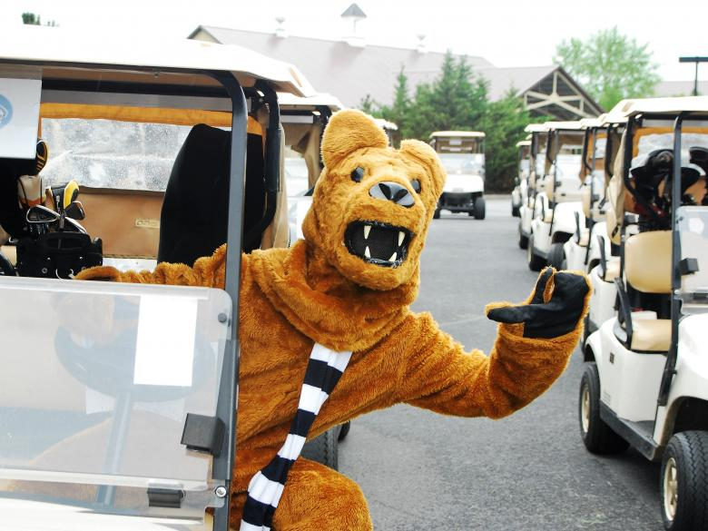 Nittany Lion mascot in golf cart at Penn State Great Valley golf outing