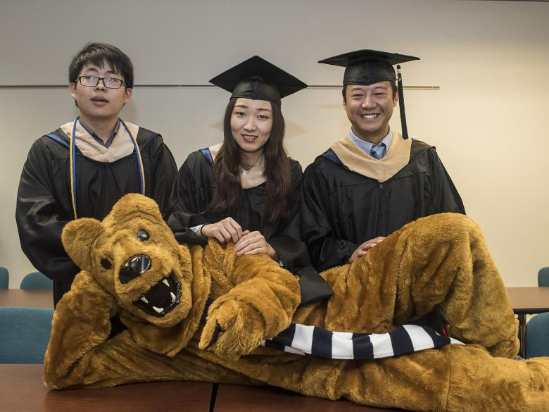 Phot of grads with Nittany Lion mascot