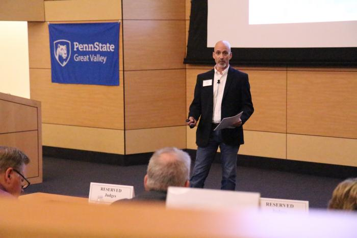Wayne Frick, founder of Chirpsounds, presents his product at Penn State Great Valley's Lion Cage competition