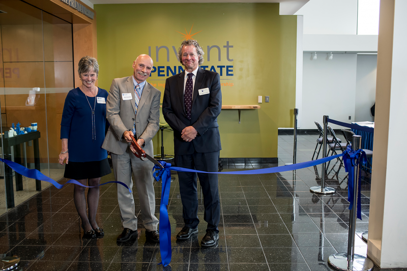 Marybeth DiVencenzo, Neil Sharkey, and James Nemes cut the ribbon to inaugurate the REV-UP Center for Entrepreneurship