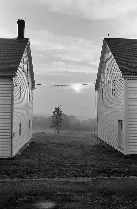 Photo of two houses on a farm