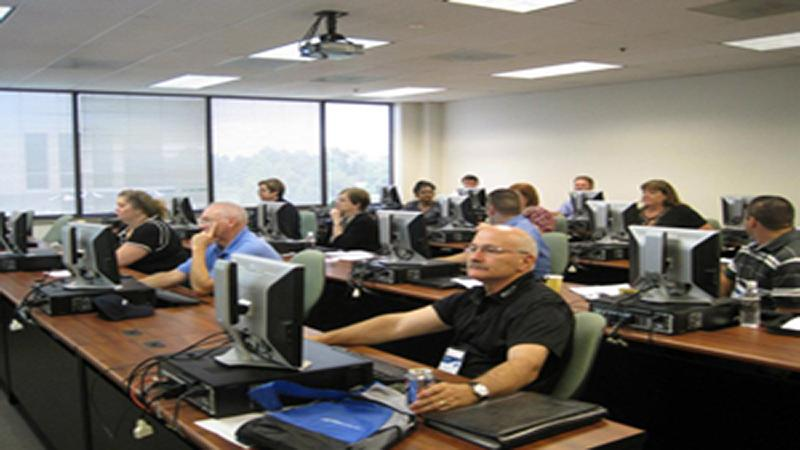 Photo of students working at computers in classroom