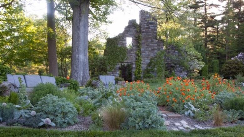 Blooming garden and stone wall at Chanticleer