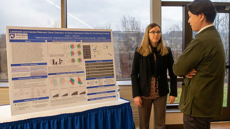 A student explaining her research to a judge
