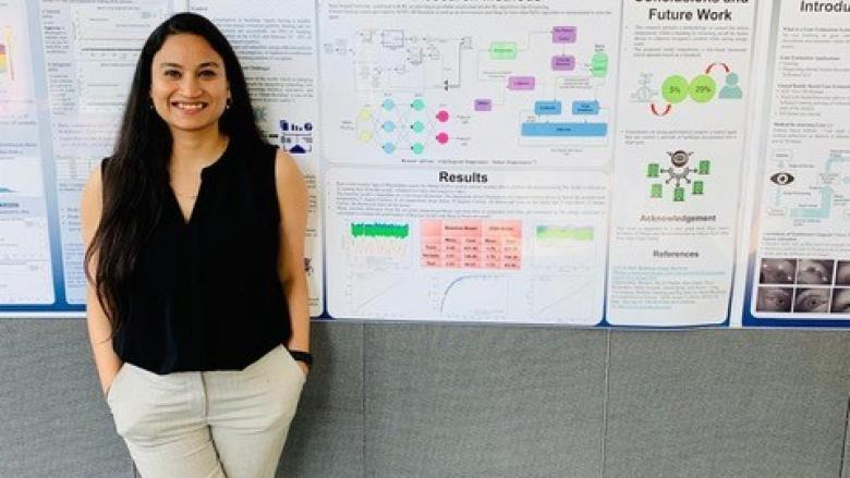 Anchal Gupta in front of her poster presentation