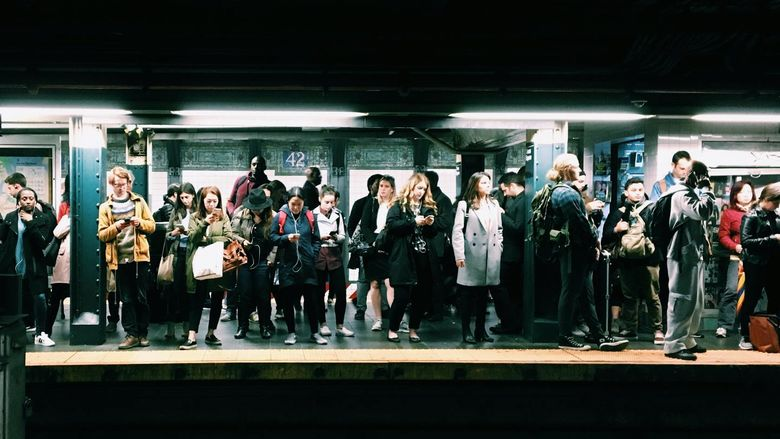 People waiting at a subway station