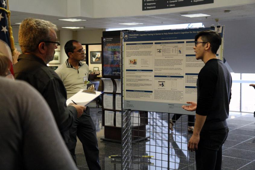 Engineering student presenting research to judges