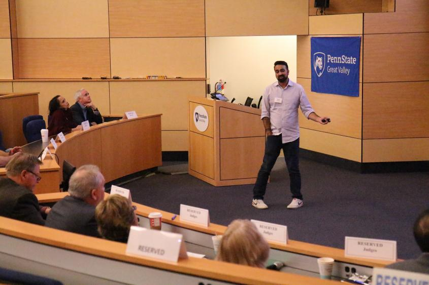 Raghav Hardas pitches his app, Squawkr, to a panel of judges at Penn State Great Valley's Lion Cage competition